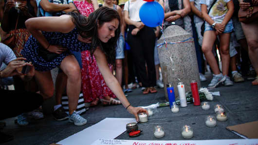 People attend a candlelight vigil for the victims of truck attack in Nice, France, at Washington Square Park in New York on July 16 2016.
