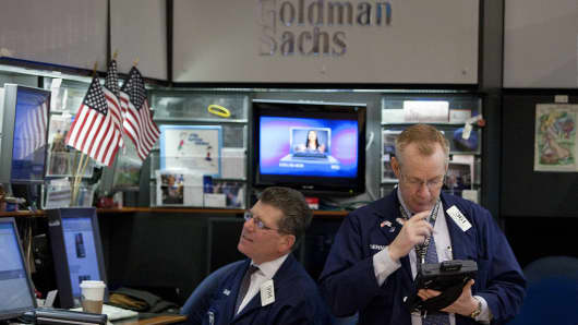 Traders work in the Goldman Sachs booth at the New York Stock Exchange