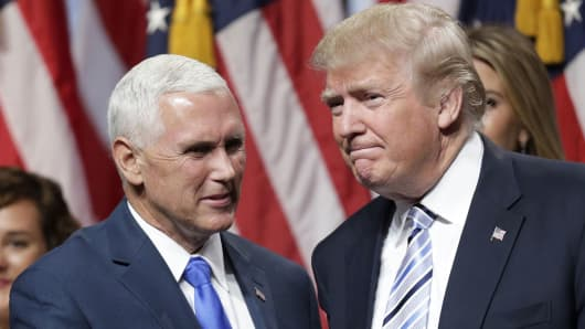 Presidential candidate Donald Trump (R) shakes hands with Indiana Governor Mike Pence after Trump introduced Pence as his vice presidential running mate in New York City, July 16, 2016.