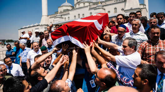 People carry the coffin of a victim of the coup attempt at Kocatepe Mosque in Ankara, Turkey on July 18, 2016.