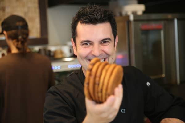 Sweet Corner Bakeshop owner Rodolfo Goncalves poses at his New York City bakery on Friday, June 3.
