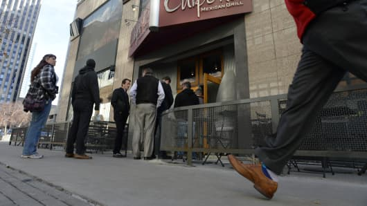 Patrons of Chipotle restaurant in Denver line up for lunch.