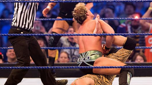 Chris Jericho puts Jimmy 'Superfly' Snuka into the 'walls of Jericho' during their match at 'WrestleMania 25' at the Reliant Stadium on April 5, 2009 in Houston, Texas.