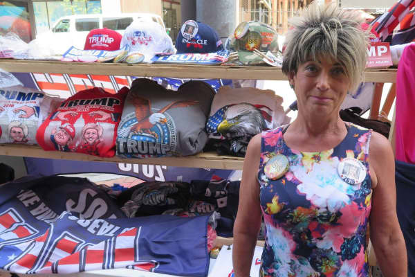 A woman sells Donald Trump merchandise outside the GOP Convention in Cleveland on July 18, 2016.