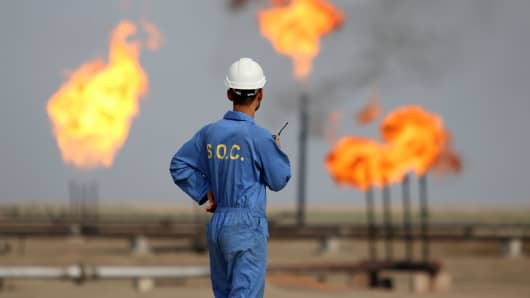 An Iraqi labourer works at an oil refinery in the southern town Nasiriyah.