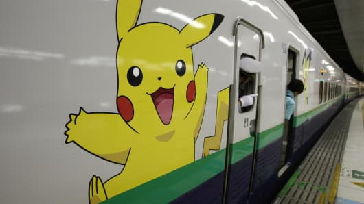 Pokemon game characters of Japanese video game manufacturer Nintendo are on display on a subway train car in Tokyo, Japan.