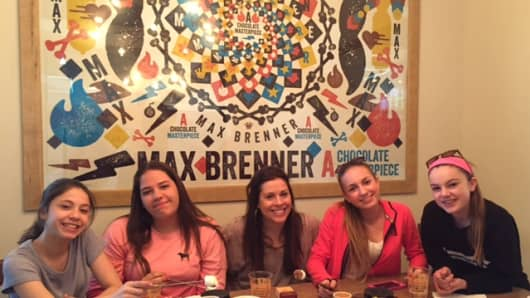 Shari Lyons (center) enjoys fondue with the girls at Max Brenner, a chocolate shop.