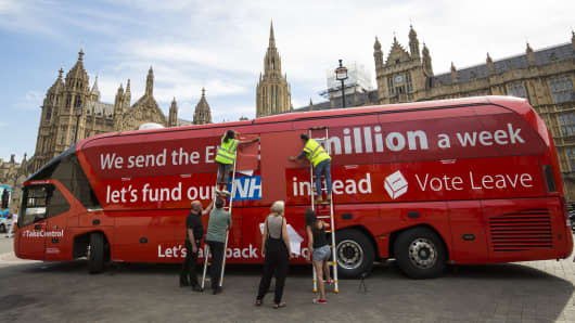 A 'Vote LEAVE' battle bus is re-branded outside the Houses of Parliament in Westminster by the environmental campaign group Greenpeace on July 18, 2016 in London, England.