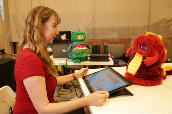"USC Professor Maja Mataric plays ""Go Fish"" with DragonBot."