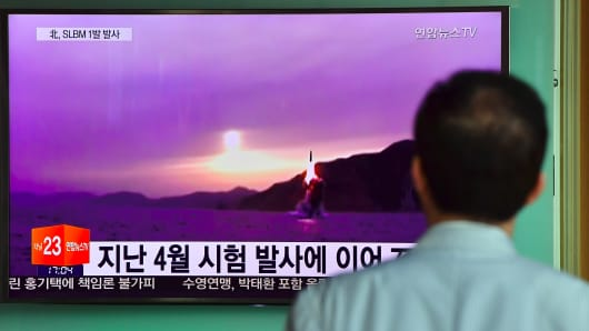A man watches a television news broadcast at a railway station in Seoul on July 9, 2016, showing file footage of a North Korean missile launch. North Korea on July 9 test-fired what appeared to be a submarine-launched ballistic missile.