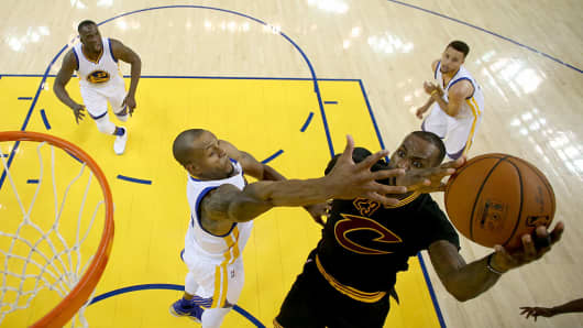 Andre Iguodala #9 of the Golden State Warriors defends LeBron James #23 of the Cleveland Cavaliers in Game 7 of the 2016 NBA Finals at ORACLE Arena on June 19, 2016.