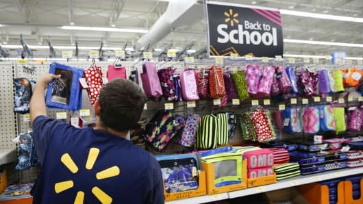 A Wal-Mart Stores Inc. associate organizes school supplies at a Wal-Mart Stores Inc. location in the Porter Ranch neighborhood of Los Angeles, California.