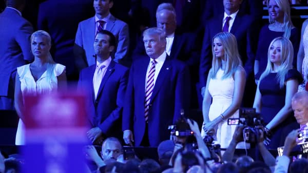 L-R) Vanessa Trump, Donald Trump Jr., Republican presidential candidate Donald Trump, Ivanka Trump and Tiffany Trump stand as they listen to Sen. Ted Cruz (R-TX) speak during the third day of the Republican National Convention on July 20, 2016 at the Quicken Loans Arena in Cleveland, Ohio.