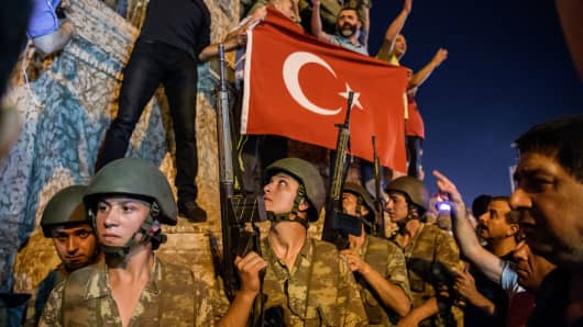 Turkish solders at Taksim square as people protest against the military coup in Istanbul on July 16, 2016.