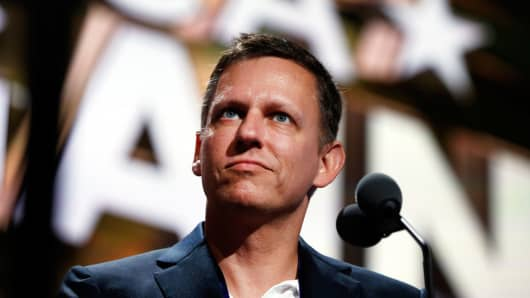 Peter Thiel looks over the podium of the Republican National Convention in Cleveland, Tuesday, July 19, 2016.