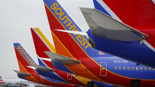 Southwest Airlines Co. Boeing Co. 737 aircraft sit on the tarmac at John Wayne Airport (SNA) in Santa Ana, California.