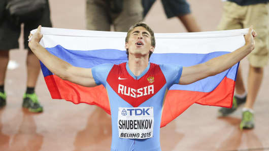 Sergey Shubenkov of Russia celebrates after crossing the finish line to win gold in the Men's 110 Meter Hurdles final during the 15th IAAF World Athletics Championships Beijing 2015 on August 28, 2015 in Beijing, China.