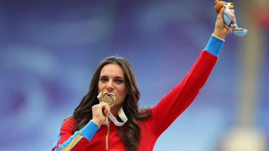 Gold medalist Yelena Isinbayeva of Russia poses on the podium during the medal ceremony for the Women's Pole Vault during day six of the 14th IAAF World Athletics Championships Moscow 2013 on August 15, 2013.