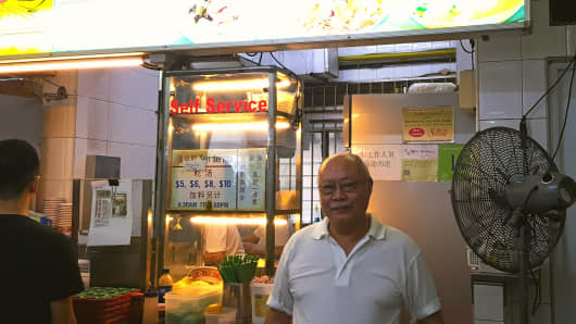 Hill Street Tai Hwa Pork Noodle owner and chef Tang Chay Seng at his stall, a day after winning a Michelin star.