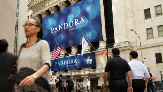 A banner for Pandora Media, the online-radio company, hangs in front of the New York Stock Exchange.