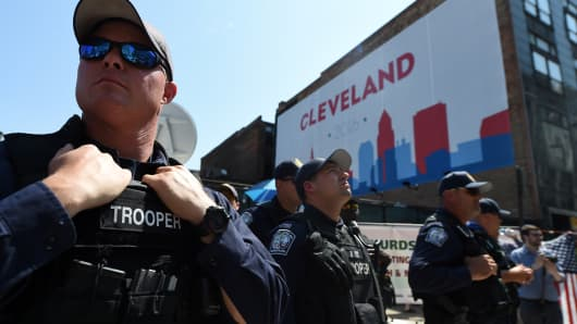 Police, state troopers and other security forces are seen outside the Quicken Loans Arena in Cleveland, Ohio, on July 20, 2016, on the third day of the Republican National Convention. Police arrested several people as clashes erupted when protesters tried to burn American flags.