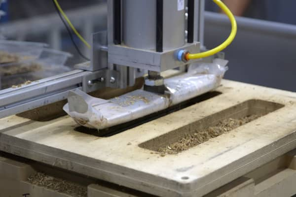 Pressed by a machine in Ecovative's Green Island facility, these nontoxic engineered wood products are able to be molded into custom shapes or pressed into boards.