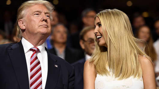 Republican presidential nominee, sits with daughter Ivanka Trump during the Republican National Convention (RNC) in Cleveland, Ohio, U.S., on Wednesday, July 20, 2016.