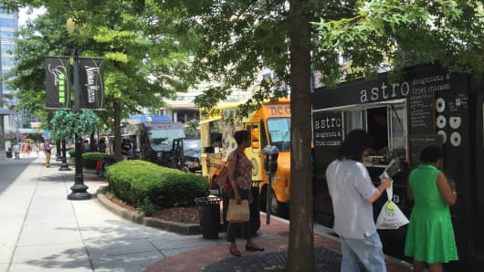 Food Trucks lined up near the curb side.
