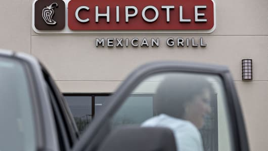 A customer exits a vehicle outside a Chipotle Mexican Grill Inc.