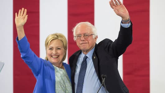 U.S. Presidential candidate Hillary Clinton and U.S. Senator and former presidential candidate Bernie Sanders