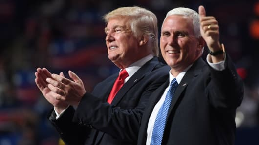 Republican Presidential candidate Donald Trump and Republican Vice Presidential candidate Mike Pence celebrate, during the final day of the Republican National Convention on Thursday, July 21, 2016.