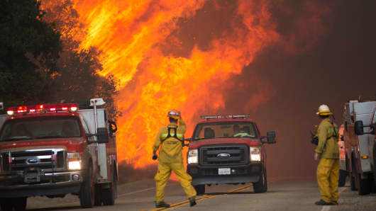 Firefighters are forced to retreat as flame close in on them in Placerita Canyon at the Sand Fire on July 24, 2016 in Santa Clarita, California.