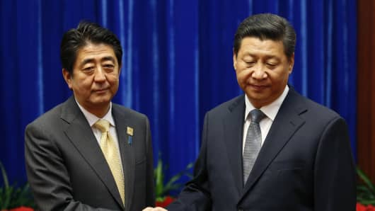 Japan's Prime Minister Shinzo Abe (left) shakes hands with China's President Xi Jinping (right), during their meeting at the Great Hall of the People in Beijing, China.