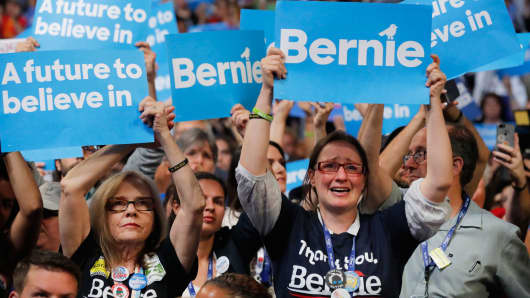 Supporters of Sen. Bernie Sanders cheer at the end of his speech during the first session at the Democratic National Convention in Philadelphia, July 25, 2016.