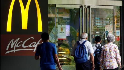 People enter a McDonald's restaurant