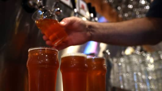 Russian River Brewing Company bartender pours a glass of the newly released Pliny the Younger triple IPA beer in Santa Rosa, California.