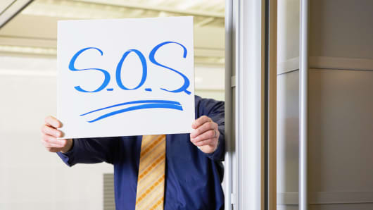 Worker with SOS sign