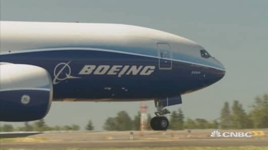 Boeing reports smaller-than-expected loss