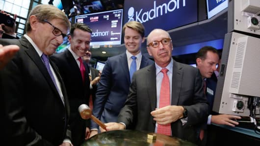 Kadmon Holdings President & CEO Harlan Waksal, right, rings a ceremonial bell to mark the beginning of trading of his company's IPO, on the floor of the New York Stock Exchange, Wednesday, July 27, 2016.