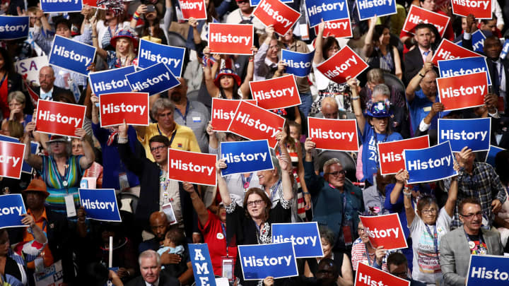Delegates hold up signs and cheer on the second day of the Democratic National Convention at the Wells Fargo Center, July 26, 2016 in Philadelphia.