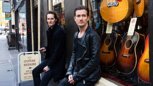 SoundCloud co-founders Eric Wahlforss, left, and Alexander Ljung pose for a photograph outside a guitar shop in London, May 3, 2016.