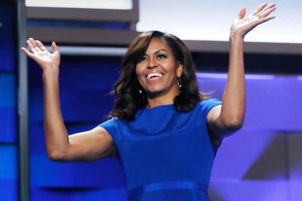 Michelle Obama waves as she appears onstage during the first session at the Democratic National Convention in Philadelphia, July 25, 2016.