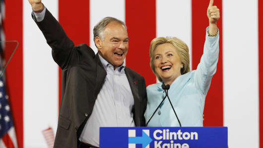 Democratic vice presidential candidate Senator Tim Kaine (D-VA) waves with his presidential running-mate Hillary Clinton after she introduced him during a campaign rally in Miami, July 23, 2016.