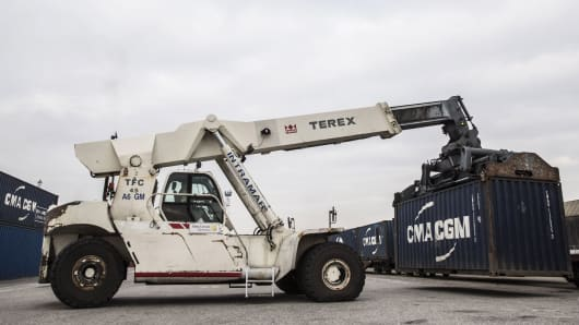 A Terex reach stacker transports a CMA CGM SA shipping container in the Med Europe Terminal at the Port of Marseille, France.