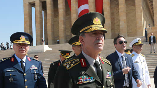 Chief of the General Staff of the Turkish Armed Forces, Hulusi Akar (C) are seen during Turkish Supreme Military Council (YAS) members' visit at Anitkabir, mausoleum of Mustafa Kemal Ataturk in Ankara, on July 28, 2016.