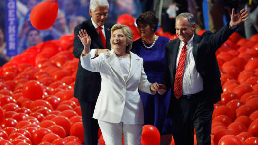 Democratic presidential nominee Hillary Clinton and her vice presidential running mate Senator Tim Kaine, and their spouses Anne Holton and former president Bill Clinton, walk through balloons at the Democratic National Convention in Philadelphia, July 28, 2016.