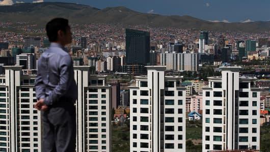 A man overlooks buildings in Ulaanbaatar, Mongolia