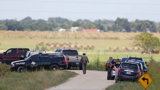 Authorities investigate the site of a hot air balloon accident in Maxwell, Texas on July 30, 2016.