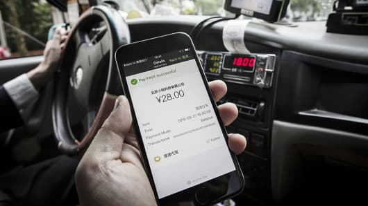 The payment confirmation page is displayed on the Didi Chuxing application in this arranged photograph taken in Shanghai, China, on Sunday, May 22, 2016.