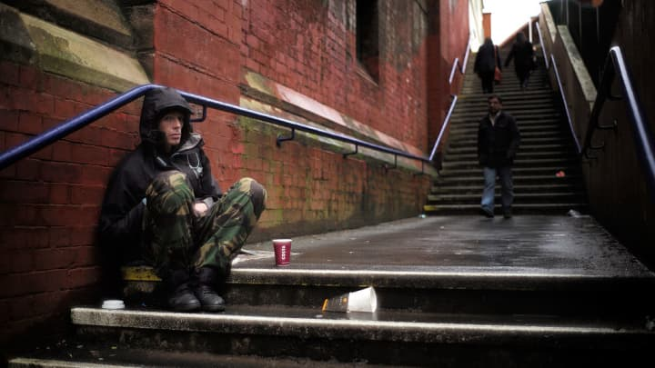 A man begs for loose change on the streets of Manchester in the U.K.